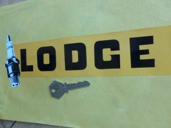 "Lodge Text and Spark Plug Sticker. 10""."