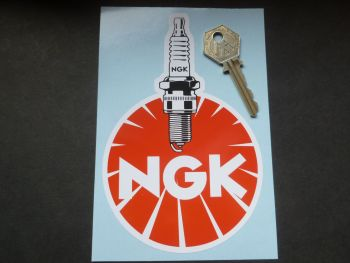 "NGK Round with Vertical Detailed Plug Sticker. 4"" x 6""."