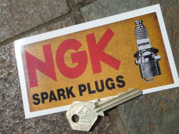 "NGK Spark Plugs Distressed Style Oblong Sticker. 4.75""."
