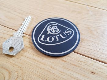 Lotus Silver on Black Round Self Adhesive Car Badge. 60mm.