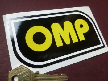 "OMP Black, White, & Yellow Shaped Sticker. 4.75""."