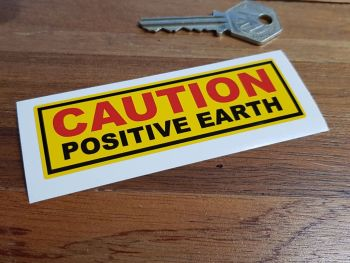 "Caution Positive Earth Yellow Sticker. 4""."