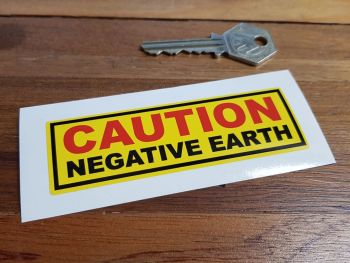 "Caution Negative Earth Yellow Sticker. 4""."