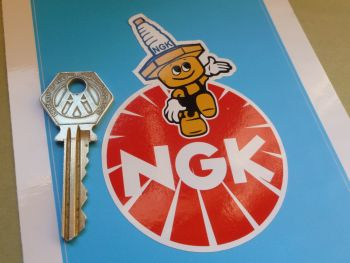 NGK Round with Vertical Spark Plug Man Sticker. 4""