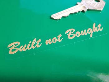 "Built Not Bought Brushscript Text Gold & Clear Sticker 3.5""."