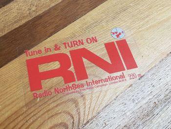 "Radio RNI NorthSea International Red & Clear Sticker. 3.5""."