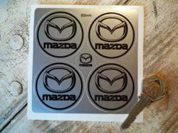 Mazda Black & Silver Wheel Centre Stickers. Set of 4. 50mm