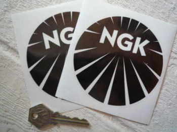 "NGK Black & Clear Round Stickers. 4"" Pair."