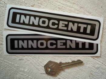"Innocenti Silver on Black. Text Stickers. 6"" Pair."