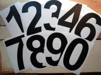 A Racing Number Sticker. Arial Font. Various Sizes.