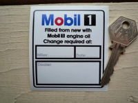 "Mobil One Oil Change Required At Sticker. 2.5""."