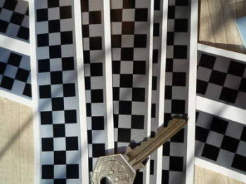 "Chequered Tape Checkered Check Black & Silver Decal. 46"" x 1""."