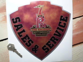 "Raleigh Sales & Service Shield Shaped Sticker. 8""."