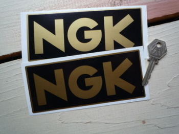 "NGK Black & Gold Oblong Stickers. 6"" Pair."
