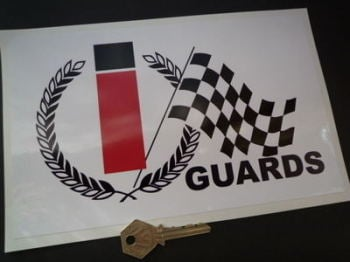 "Guards Cigarettes Sponsors Oblong Sticker. 9.5""."