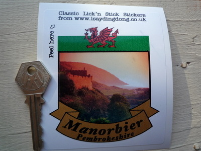 "Manorbier Pembrokeshire Scroll Style Travel Sticker. 2"" or 3""."