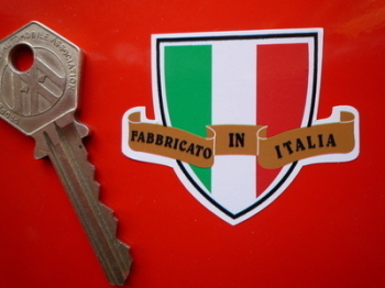 "Made in Italy. Fabricato In Italia. Shield & Scroll Sticker. 2""."