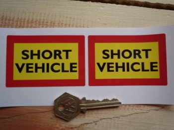 "Short Vehicle Warning Stickers. 3"" Pair."
