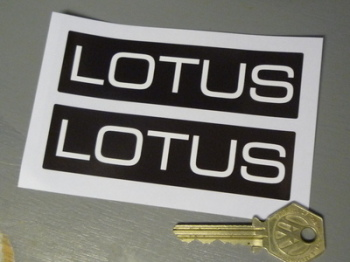 "Lotus White Text on Black Oblong Stickers. 4.25"" Pair."