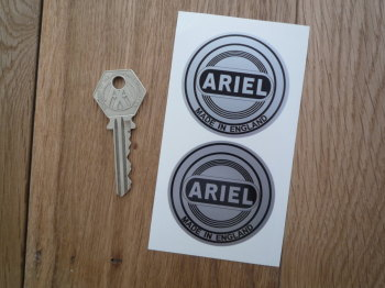"Ariel Made in England Black & Silver Circular Stickers. 2"" Pair."