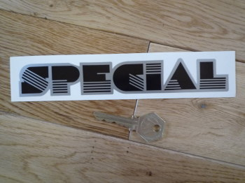 "Special Black & Silver Shaped Sticker. 7.25""."