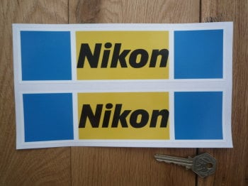"Nikon Yellow, Blue, Black, & White, Oblong Stickers. 8"" Pair."