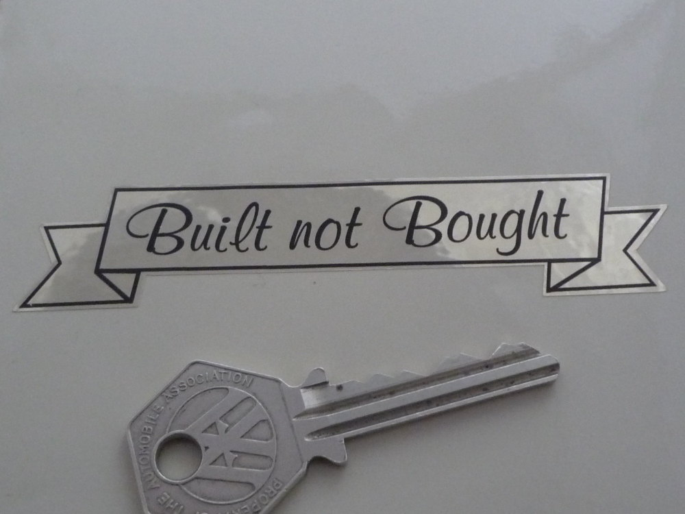 """Built Not Bought Gold Tone Foil Style Scroll Sticker. 4""""."""