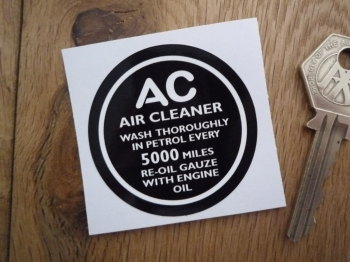 "AC Air Cleaner Wash In Petrol Every 5,000 Miles. Black & White Sticker. 2""."