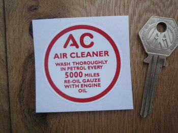 "AC Air Cleaner Wash In Petrol Every 5,000 Miles. Red & White Sticker. 2""."