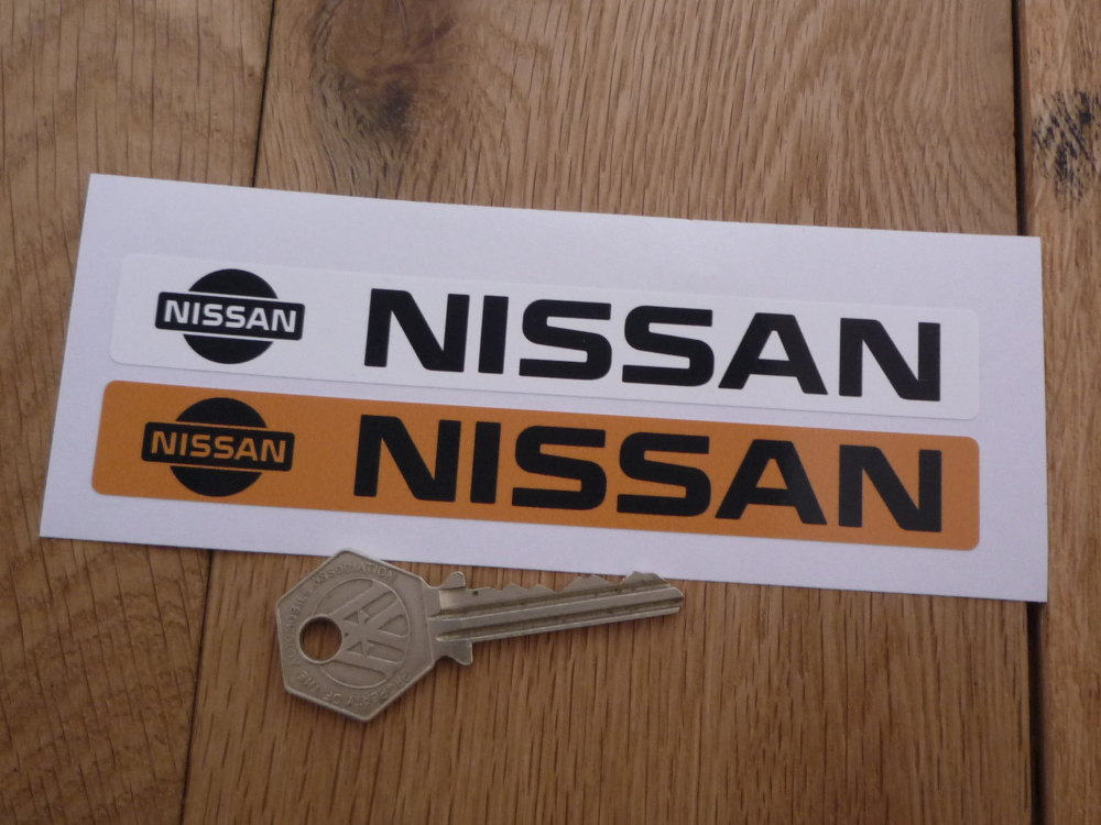 """Nissan Number Plate Dealer Logo Cover Stickers. 5.5"""" Pair."""