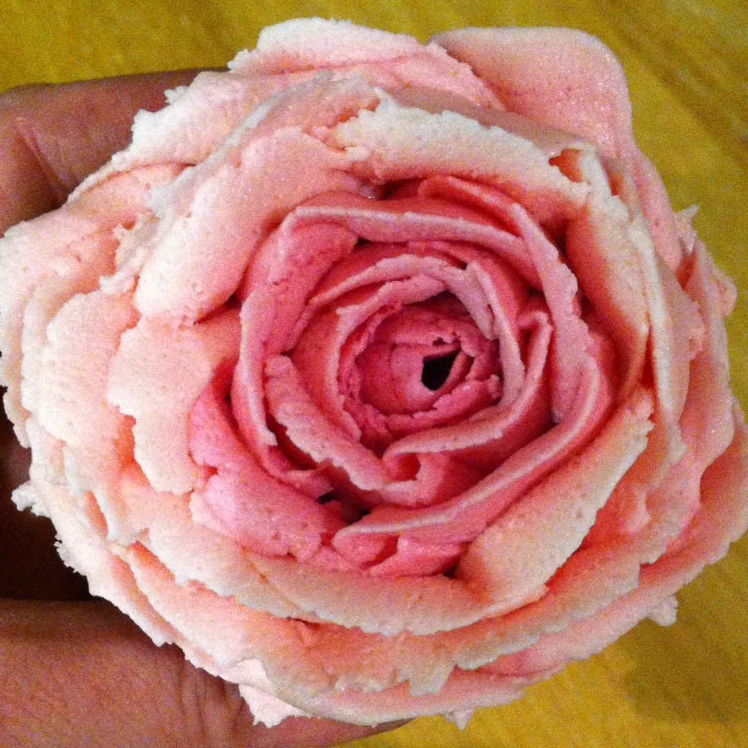 Hand-piped buttercream rose