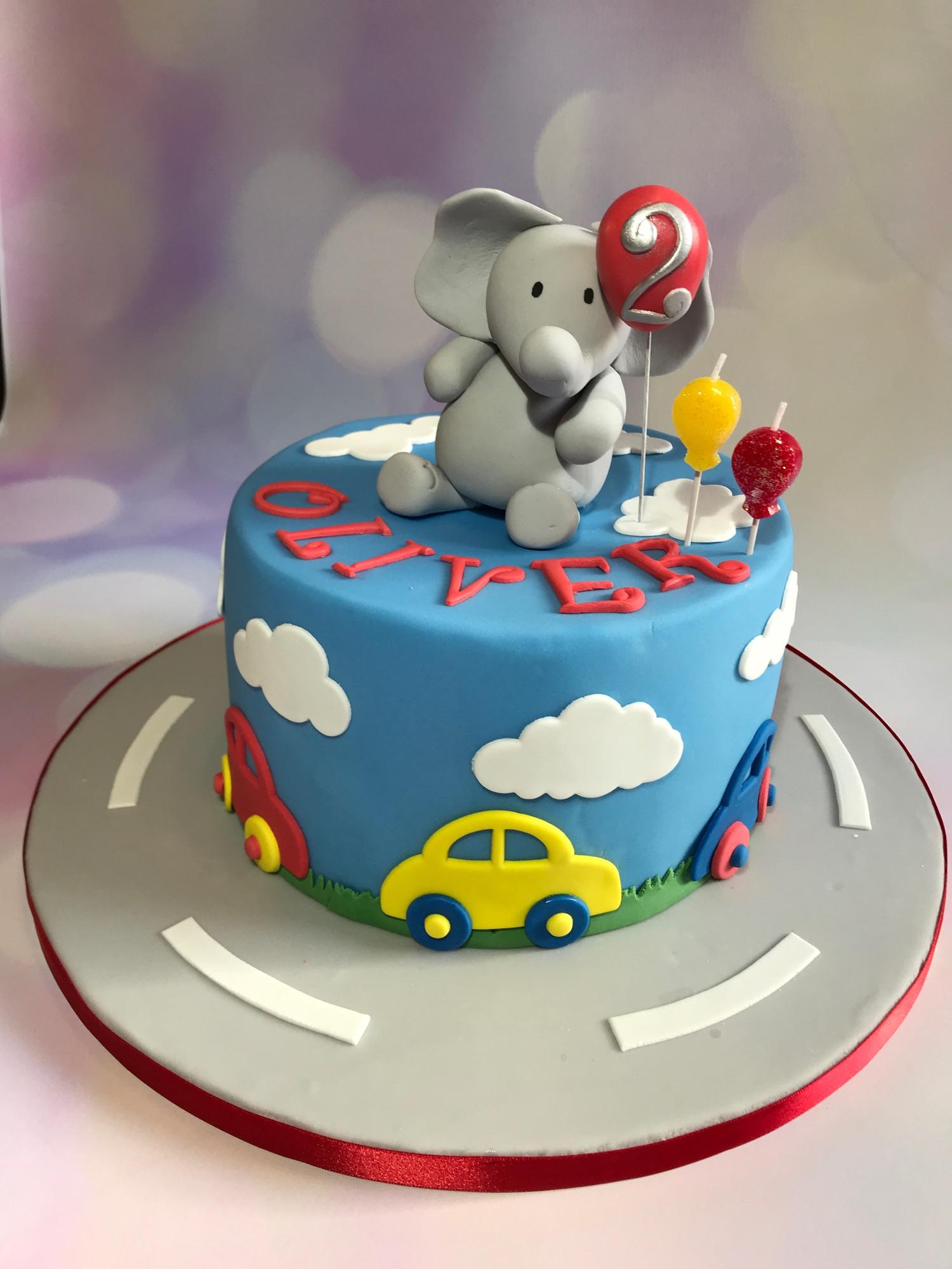 Elephant and Cars