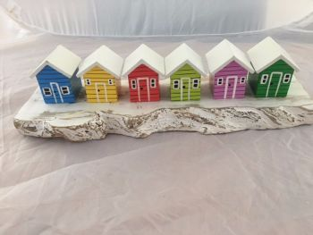 Row of 6 Wooden Colourful Beach Huts on White Cliffs