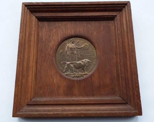 Memorial Plaque in Oak frame to Clifford Yvon Humphries / killed during an