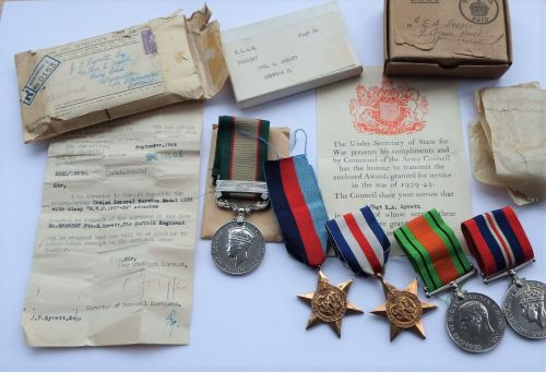 A WW2 Northwest Europe Casualty Group to 5826397 Pte E Syrett Suffolk R