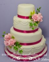 hot pink ribbon with pale pink rose wedding cake