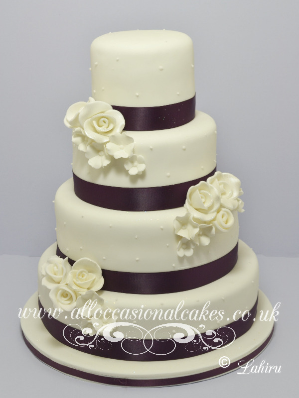 plum colour ribbon with ivory rose £ 290