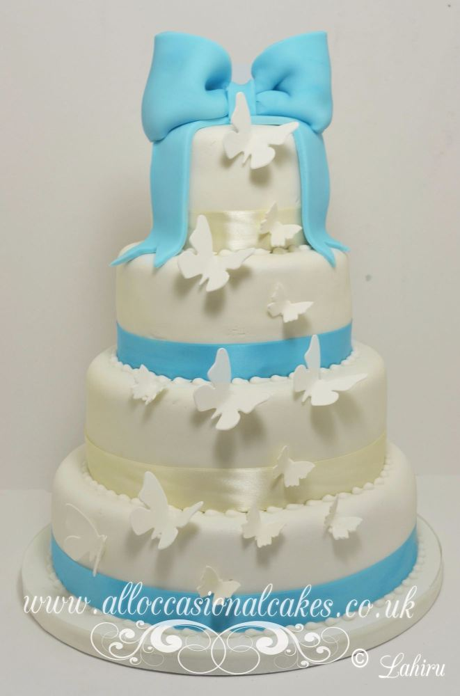 butterfly cascade with blue bow cake