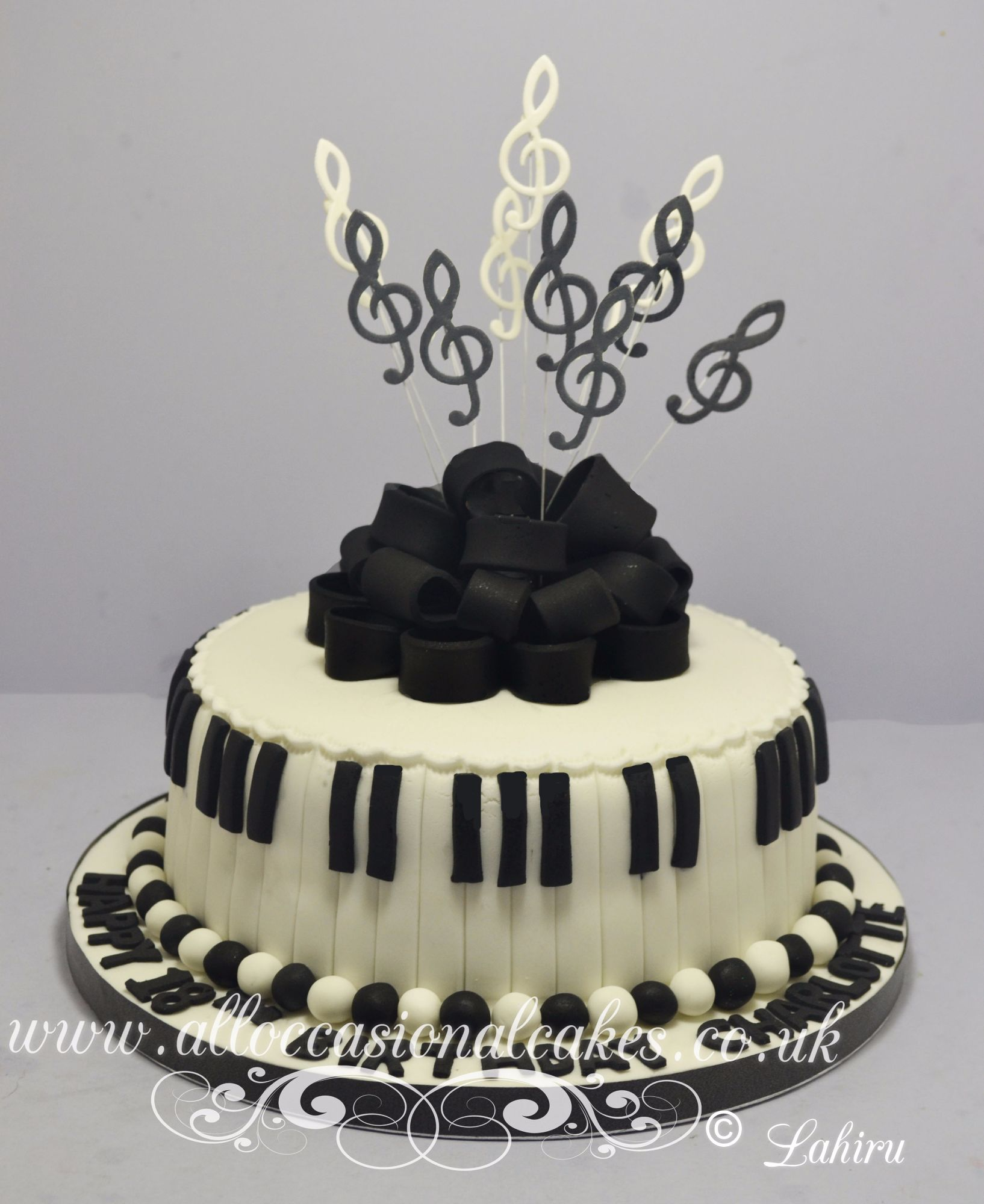 black bow with music notes cake