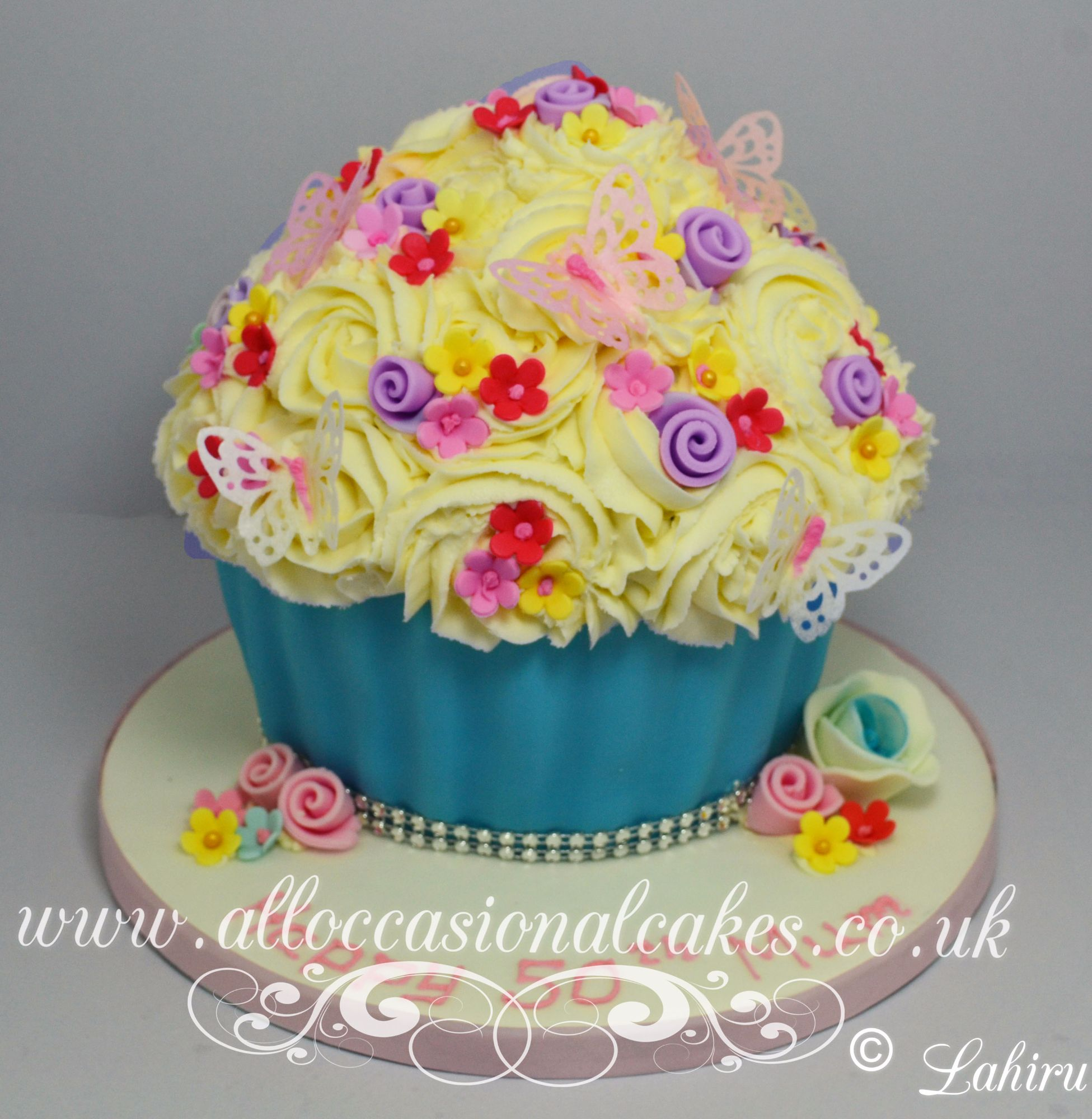 giant cupcake with flowers and butterflys