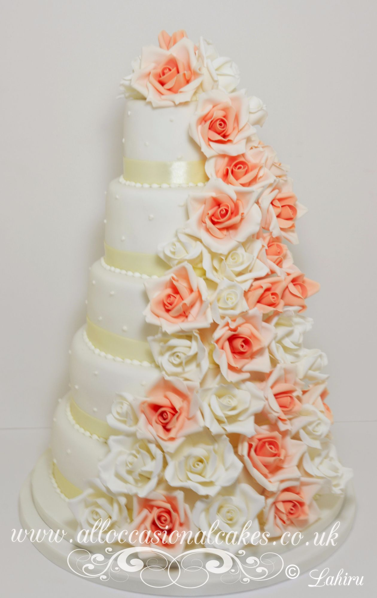 peach and ivory rose cascade wedding cake