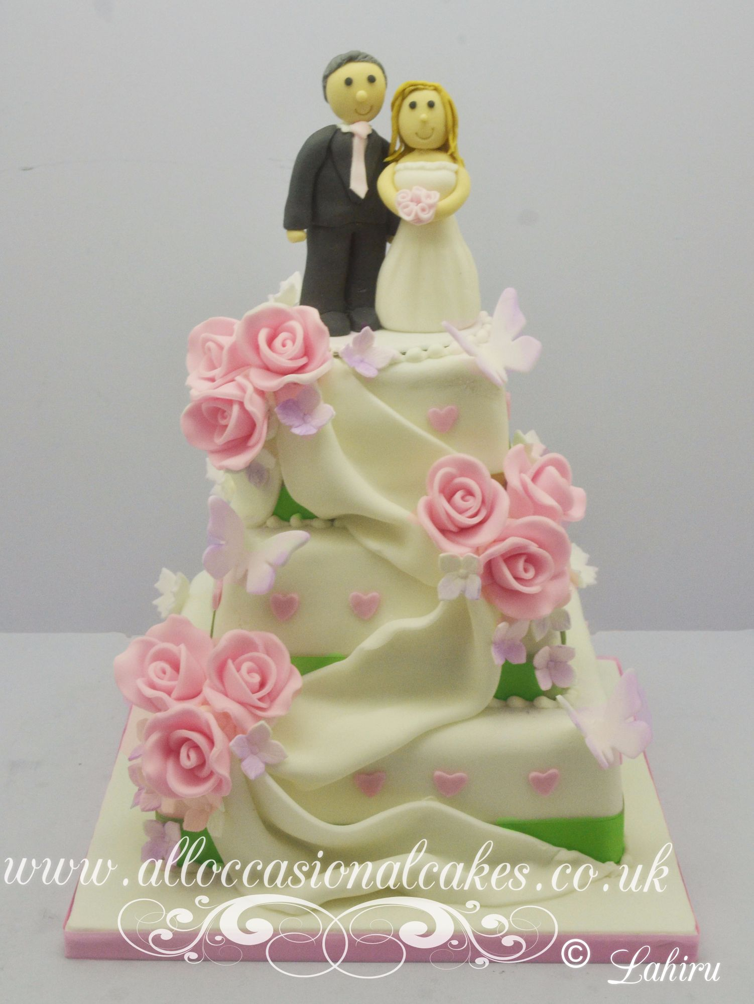 Pink rose & drapes wedding cake