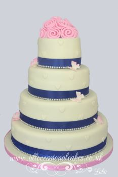 navy blue ribbon with roses wedding cake