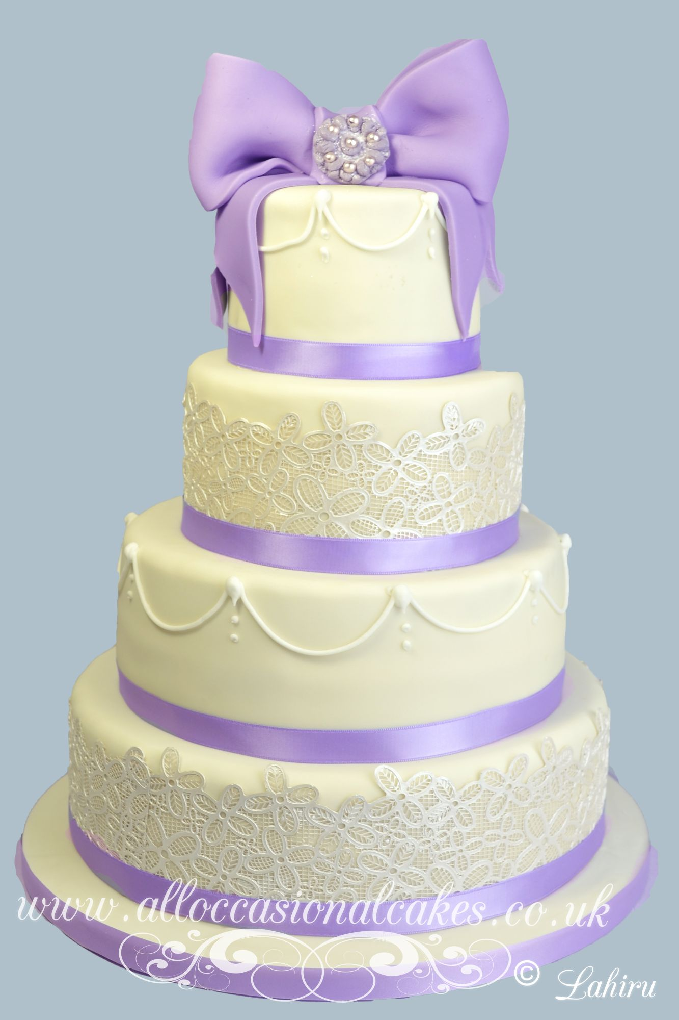 Lilac bow with lace wedding cake