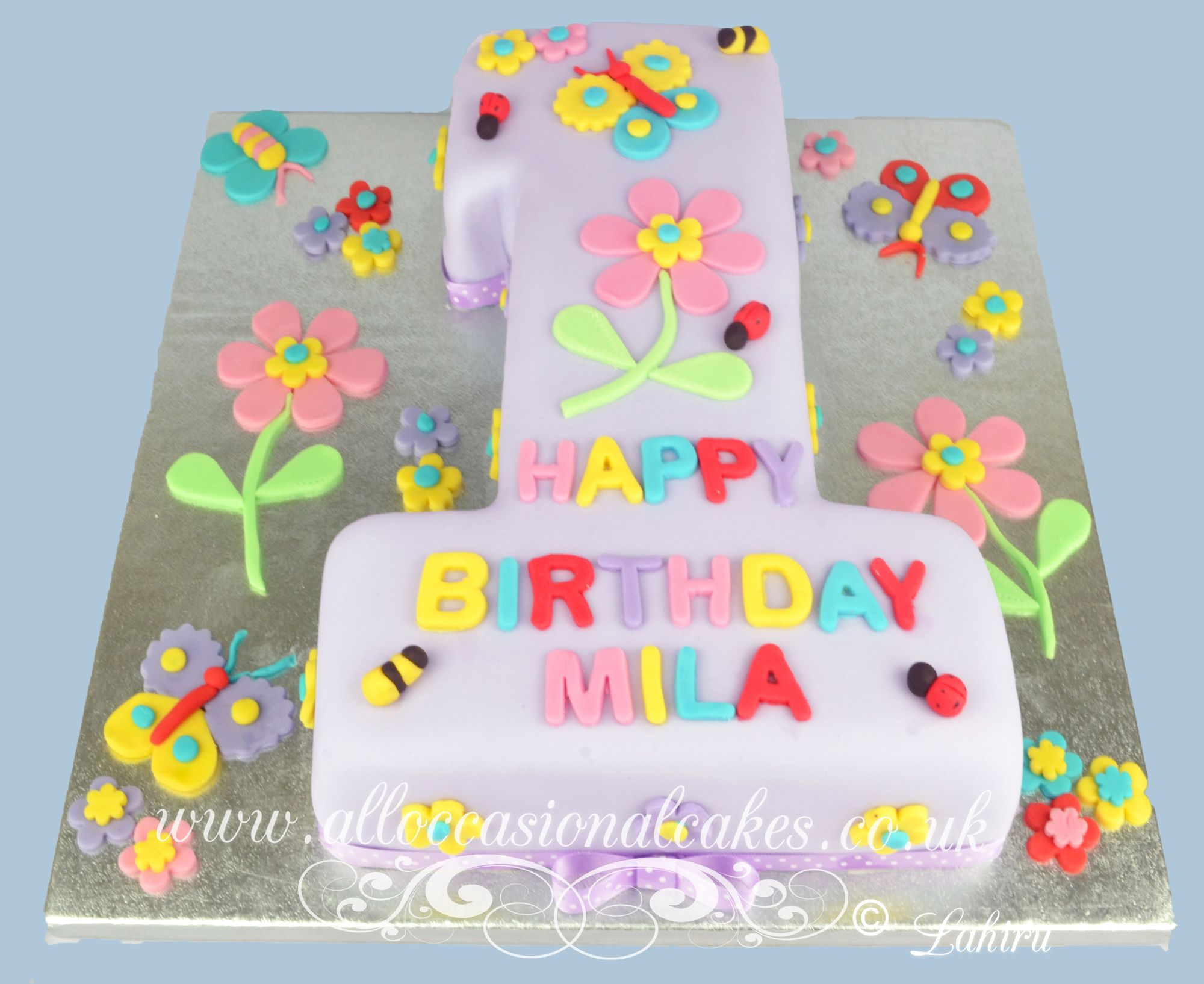 colourfull hand craft pattern 1st birthday cake