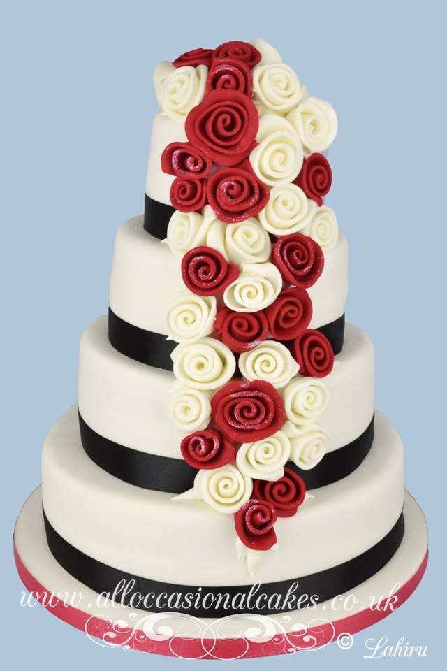ruby and ivory rose cascade wedding cake