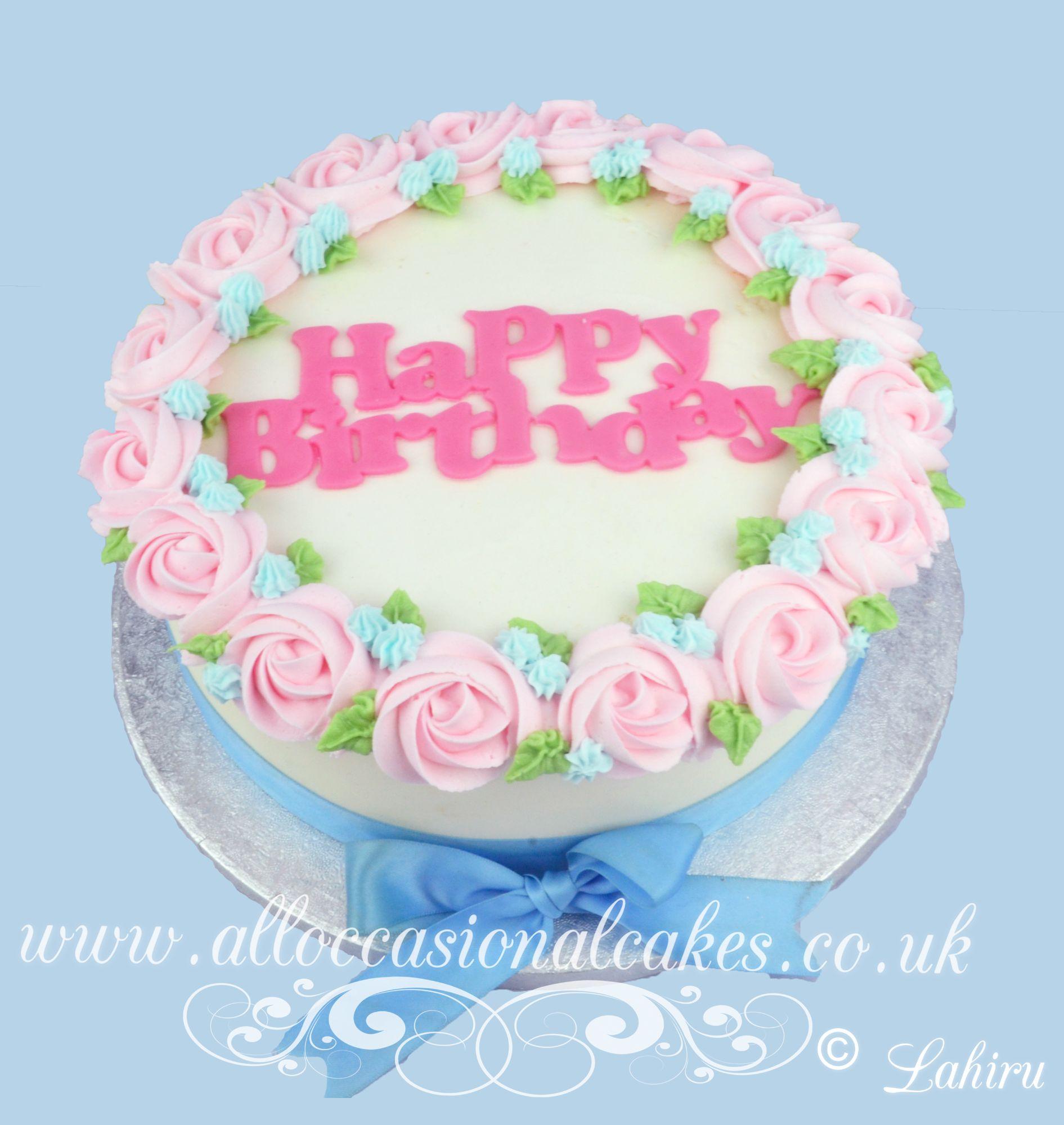 pink butter cream rose blue flower cake