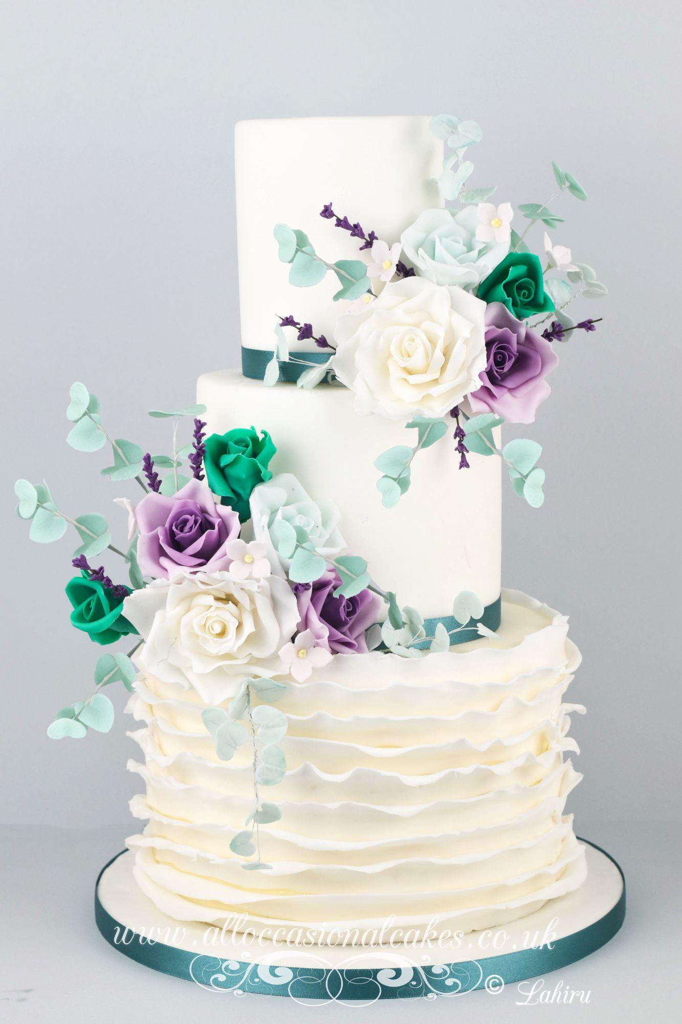 eucalyptus leaves with teal green rebbon wedding cake,Best Cake Shops