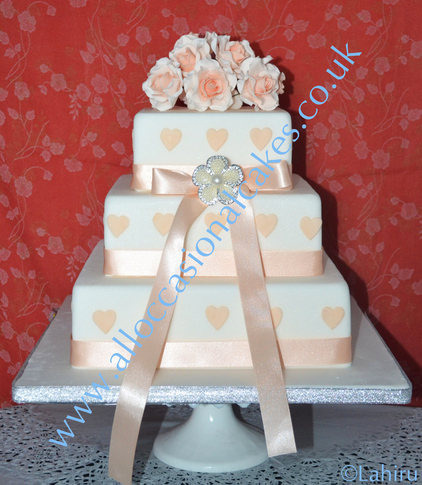 Peach Roses With Hearts Wedding cake, wedding cakes designers of clifton, magic design wedding cakes, bristol wedding cakes, cakes pictures, magic wedding cakes,  uk cakes, uk wedding cakes, emersons green wedding cakes, cheap cakes, best cakes, international wedding cakes, international cakes, egg free cakes, egg less cakes, downend cakes, king cakes, downend wedding cakes, colourful cakes, all occasional cakes, cakes for all occasions, tasty wedding cakes, golden wedding cakes, sweet wedding cakes, anniversary cakes, sri lankan wedding,  wedding cakes, england wedding cakes, england cakes, birthday cakes, google cakes, winter cakes, snow cakes, topsy turvy cakes, cascade, cheap cakes, cheap wedding cakes, special wedding cakes, best cakes, uk, cakes, cake, cake makers, weddings, wedding, bristol, bristoluk, bath, bathuk, novelty cake, novelty cakes, unique cake, unique cakes, custom cake, custom cakes, birthday cake, birthday cakes, wedding cake, wedding cakes, corporate cake, corporate cakes, winning wedding cakes, winning cakes, yate wedding cakes, filton wedding cakes, clifton wedding cakes, winterbourne wedding cakes, London wedding cakes, royal wedding cakes, bristol wedding cakes, wedding cakes Bristol, wedding cake Bristol, Asian wedding cakes, indian wedding cakes, expensive cakes, expensive wedding cakes, rich wedding cakes, royal wedding cakes, rich cakes, gold wedding cakes, 24k wedding cakes, tasty wedding cakes, royal wedding cakes, queen wedding cakes, queen birthday cake, king's wedding cakes, Kings birthday cakes, prince wedding cakes, prince birthday cakes, best cakes, love cake, magic cakes, cake, fairy cakes, hot cakes, cupcakes, cupcake cakes, fondant cakes, cupcakes, my ace cakes of uk, cakes Sri Lanka, fab cakes, cakes sri lanka, south Gloucestershire, cake decoration, catering for weddings, Lahiru Peiris,, bristol wedding cakes, cakes pictures, magic cakes with iced designs, uk cakes, uk wedding cakes, emersons green wedding cakes, cheap cakes, best cakes, international wedding cakes, international cakes, egg free cakes, egg less cakes, downend cakes,king cakes, downend wedding cakes, colourful cakes, all occasional cakes, cakes for all occasions, tasty wedding cakes, golden wedding cakes, art of sweet wedding cakes, anniversary cakes,sri lankan wedding,  wedding cakes, england wedding cakes, england cakes, birthday cakes, google cakes, winter cakes, snow cakes, topsy turvy cakes, cascade, cheap cakes, cheap wedding cakes, special wedding cakes, best cakes, winning wedding cakes, winning cakes, yate wedding cakes, filton wedding cakes, clifton wedding cakes, winterbourne wedding cakes, london wedding cakes, royal wedding cakes, bristol wedding akes, wedding cakes bristol, wedding cake bristol, asian wedding cakes, indian wedding cakes, expensive cakes, expensive wedding cakes, rich wedding cakes, royal wedding cakes, rich cakes, gold wedding cakes, 24k wedding cakes, tasty wedding cakes, royal wedding cakes, queen wedding cakes, queen birthday cake, king's wedding cakes, Kings birthday cakes, prince wedding cakes, prince birthday cakes, best cakes, love cake, magic cakes, cake, fairy cakes, hot cakes, cup cakes, cupcake cakes, fondant cakes, cupcakes, my ace cakes of uk, cakes Sri Lanka, fab cakes, cakes sri lanka, american cakes, world cakes, indian cakes, ieland cakes, palace cakes, buckingham cakes, american wedding cakes, super wedding cakes, world wedding cakes, indian wedding cakes, asian wedding cakes, Lahiru Peiris