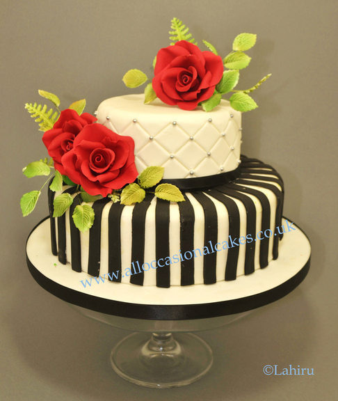 Red Rose, Stripy Themed Wedding Cake, bristol cakes, bristol wedding cakes, emerson green wedding cakes, bristol wedding cakes, magic cakes with iced designs,  uk cakes, uk wedding cakes, emersons green wedding cakes, cheap cakes, best cakes, international wedding cakes, international cakes, egg free cakes, egg less cakes, downend cakes, downend wedding cakes, colourful cakes, all occasional cakes, cakes for all occasions, tasty wedding cakes, golden wedding cakes, art of sweet wedding cakes, anniversary cakes, wedding cakes, england wedding cakes, england cakes, birthday cakes, google cakes, winter cakes, snow cakes, topsy turvy cakes, cascade, cheap cakes, cheap wedding cakes, special wedding cakes, best cakes, winning wedding cakes, winning cakes, yate wedding cakes, filton wedding cakes, clifton wedding cakes, winterbourne wedding cakes, london wedding cakes, royal wedding cakes, bristol wedding akes, wedding cakes bristol, wedding cake bristol, asian wedding cakes, indian wedding cakes, Lahiru Peiris